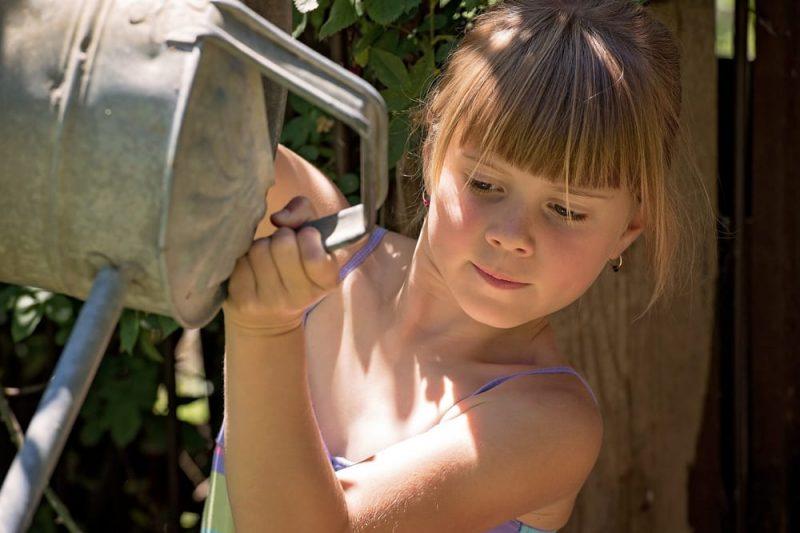 Girl watering_stock photo
